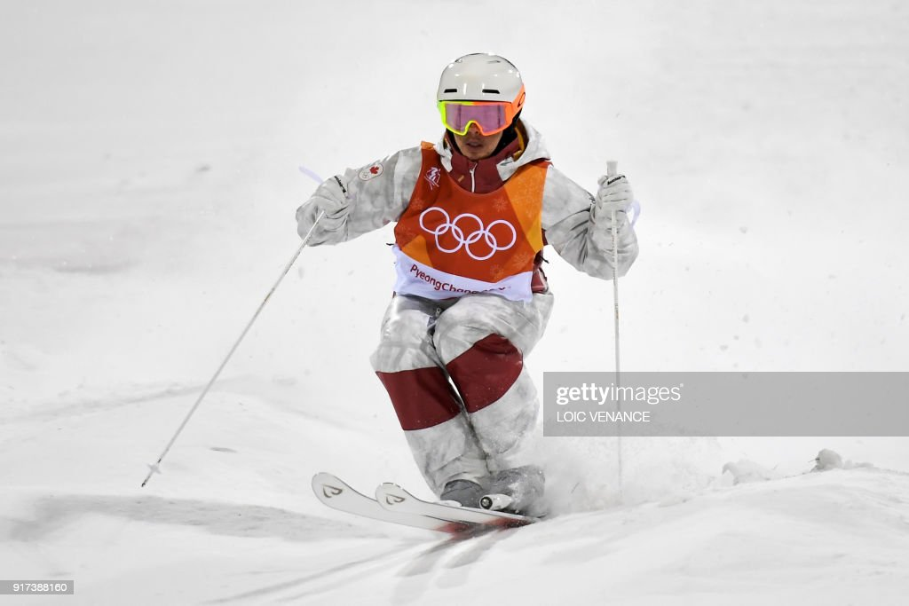 TOPSHOT - Canada's Mikael Kingsbury competes to win the men's moguls final during the Pyeongchang 2018 Winter Olympic Games at the Phoenix Park in Pyeongchang on February 12, 2018. /