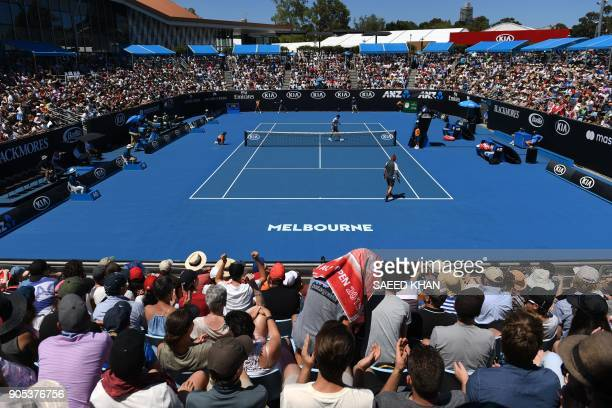 Canada's Milos Raonic and Slovakia's Lukas Lacko walk to their chairs after a game during their men's singles first round match on day two of the...