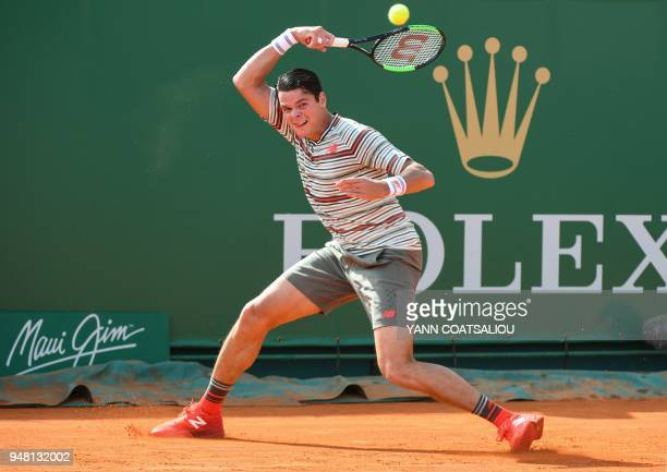 Canada's Milos Raonic hits a return to Italy's Marco Cecchinato during their men's single tennis match at the MonteCarlo ATP Masters Series...
