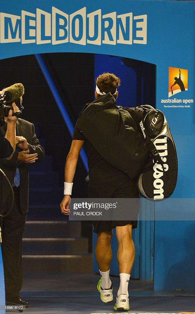 Canada's Milos Raonic leaves the court after defeat in men's singles match against Switzerland's Roger Federer on the eighth day of the Australian Open tennis tournament in Melbourne on January 21, 2013.