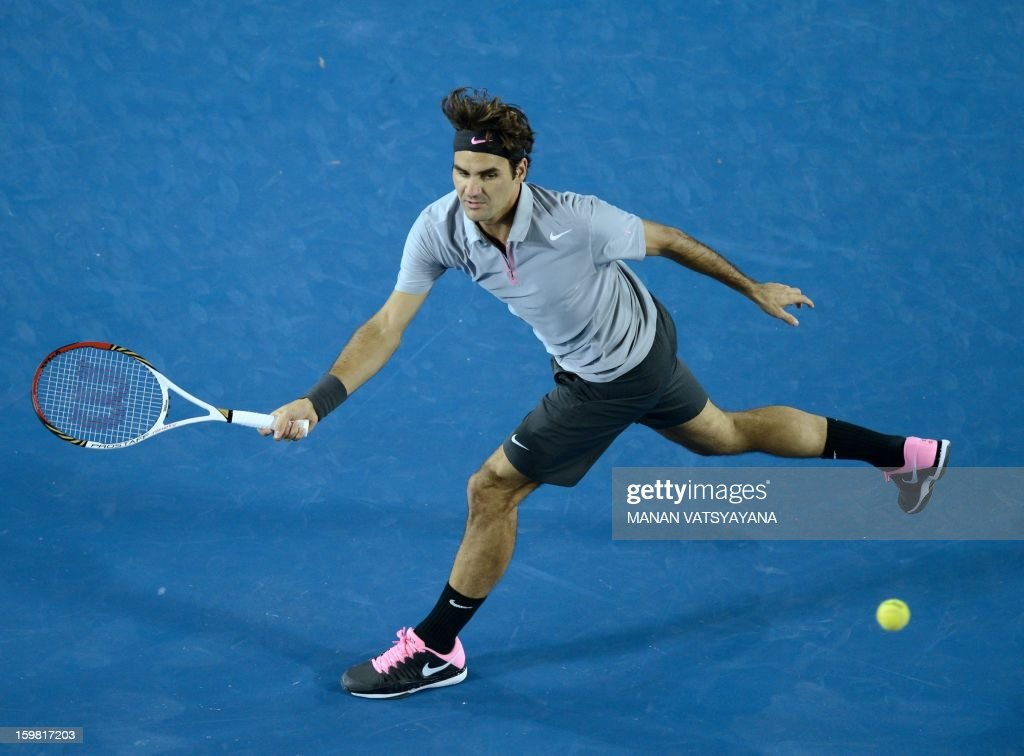 Canada's Milos Raonic plays a return during his men's singles match against Switzerland's Roger Federer on the eighth day of the Australian Open tennis tournament in Melbourne on January 21, 2013.