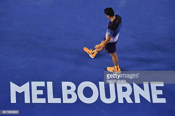 Canada's Milos Raonic prepares to serve during his men's singles semifinal match against Britain's Andy Murray on day twelve of the 2016 Australian...