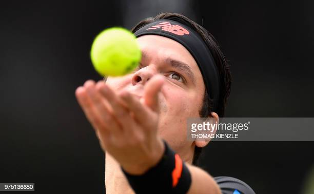 Canada's Milos Raonic prepares to serve the ball to the Czech Republic's Tomas Berdych in their quarterfinal match at the ATP Mercedes Cup tennis...
