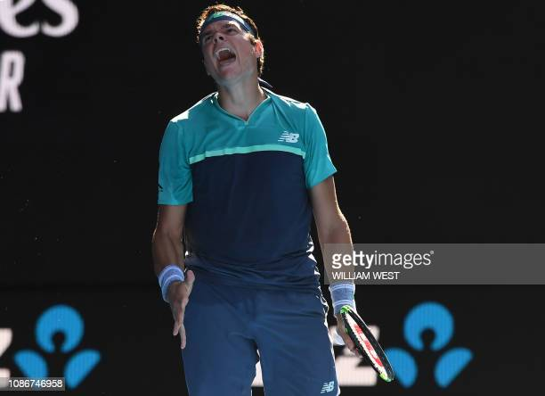 Canada's Milos Raonic reacts after a point against France's Lucas Pouille during their men's singles quarter-final match on day ten of the Australian...