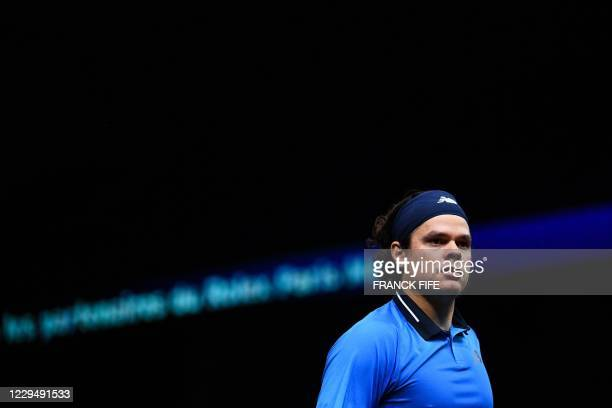 Canada's Milos Raonic reacts as he plays against France's Ugo Humbert during their men's singles quarter-final tennis match on day 5 at the ATP World...