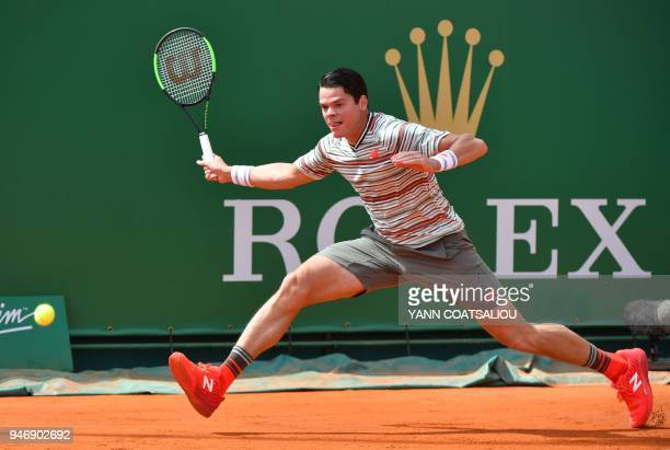 Canada's Milos Raonic returns a ball to Monaco's Lucas Catarina during their round of 64 tennis match at the MonteCarlo ATP Masters Series Tournament...