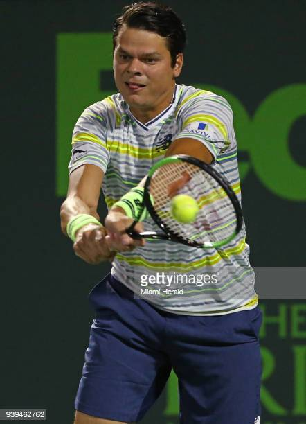 Canada's Milos Raonic returns a shot against Juan Martin del Potro of Argentina during the quarterfinals of the Miami Open on Wednesday March 28 at...