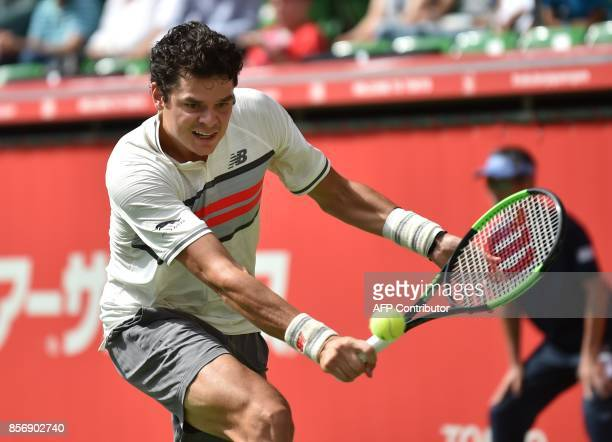 Canada's Milos Raonic returns a shot to Serbian Viktor Troicki during their men's singles first round match at the Japan Open tennis tournament in...