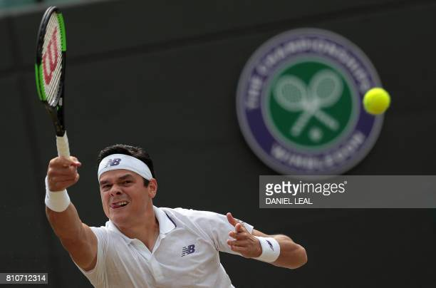 Canada's Milos Raonic returns against Spain's Albert Ramos-Vinolas during their men's singles third round match on the sixth day of the 2017...