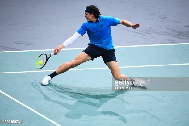 Canada's Milos Raonic returns the ball to France's Pierre-Hugues Herbert during their men's singles second round tennis match on day 3 at the ATP...