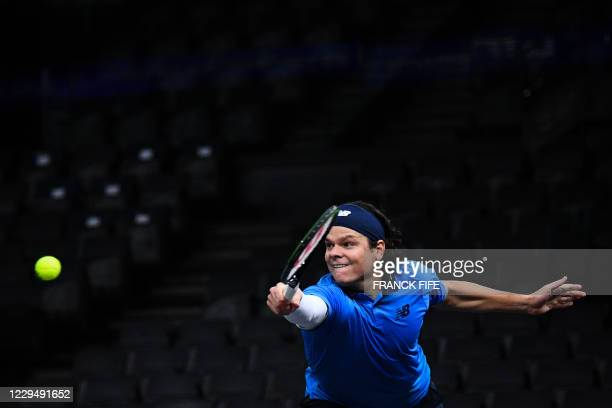 Canada's Milos Raonic returns the ball to France's Ugo Humbert during their men's singles quarter-final tennis match on day 5 at the ATP World Tour...