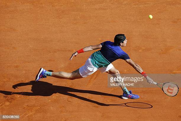 Canada's Milos Raonic returns the ball to Italy's Marco Cecchinato during the MonteCarlo ATP Masters Series Tournament on April 11 2016 in Monaco...