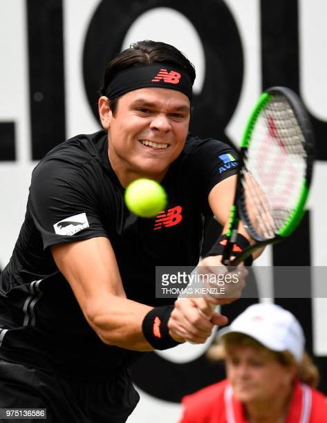 Canada's Milos Raonic returns the ball to the Czech Republic's Tomas Berdych in their quarterfinal match at the ATP Mercedes Cup tennis tournament in...