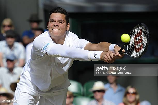 Canada's Milos Raonic returns to Switzerland's Roger Federer during their men's singles semifinal match on day 11 of the 2014 Wimbledon Championships...