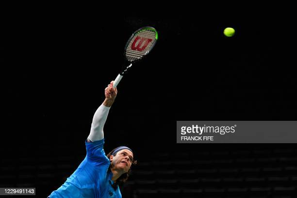 Canada's Milos Raonic serves the ball to France's Ugo Humbert during their men's singles quarter-final tennis match on day 5 at the ATP World Tour...
