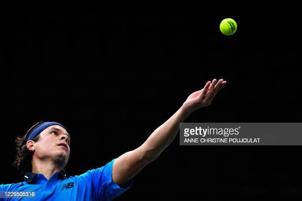 Canada's Milos Raonic serves the ball to Russia's Daniil Medvedev during their men's singles semi-final tennis match on day 6 at the ATP World Tour...