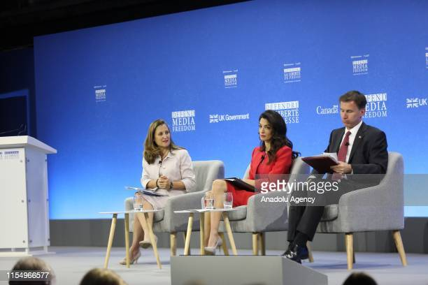 Canada's Minister for Foreign Affairs Chrystia Freeland Human rights barrister Amal Clooney and British Foreign Secretary Jeremy Hunt attend the...