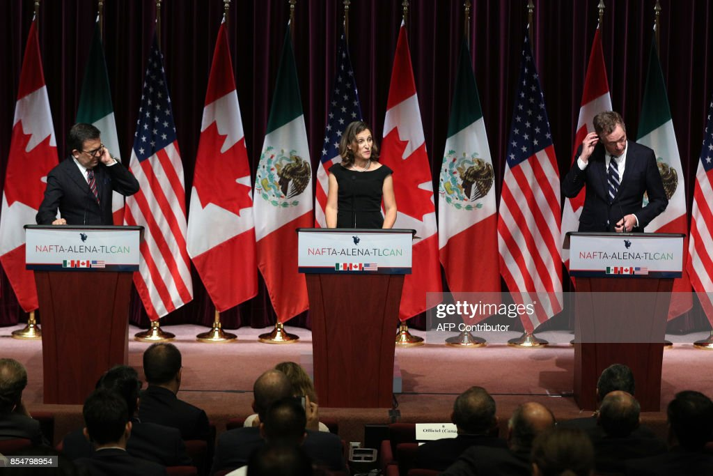 Canadas Minister of Foreign Affairs Chrystia Freeland(C), Mexicos Secretary of Economy Ildefonso Guajardo Villarreal(L) and United States Trade Representative Robert E. Lighthizer make statements during Global Affairs on the final day of the third round of the NAFTA renegotiations in Ottawa, Ontario, September 27, 2017. / AFP PHOTO / Lars Hagberg