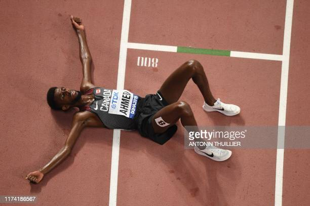 Canada's Mohammed Ahmed lies on the track after the Men's 10,000m final at the 2019 IAAF Athletics World Championships at the Khalifa International...