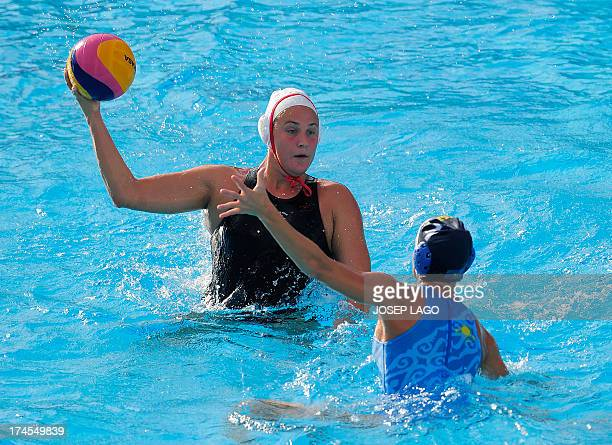 Canada's Monica Eggens is held back by Kazakhstan's Anna Zubkova during the preliminary rounds of the women's water polo at the FINA World...