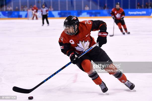 Canada's Natalie Spooner controls the puck in the women's preliminary round ice hockey match between Canada and the Olympic Athletes from Russia...