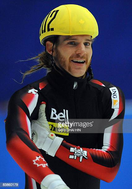 Canada's Olivier Jean smiles after winning the men's 500metre final of the 2008 ISU World Cup Short Track Speed Skating Championships in Beijing on...