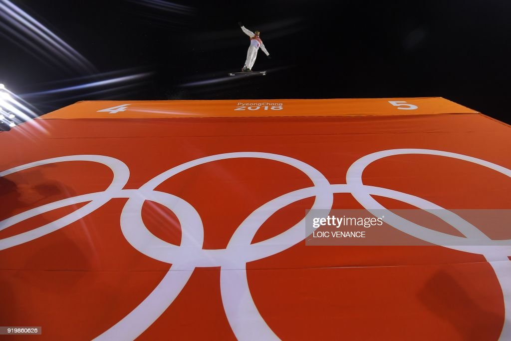 TOPSHOT - Canada's Olivier Rochon trains prior to the men's aerials final during the Pyeongchang 2018 Winter Olympic Games at the Phoenix Park in Pyeongchang on February 18, 2018. /