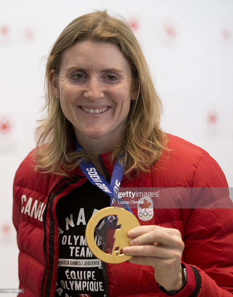 Canada's Olympic flag bearer and four-time Olympic gold medalist Hayley Wickenheiser returned to home soil at Toronto Pearson Airport Tuesday afternoon and waved to cheering fans.