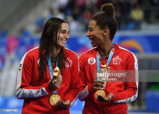 Canada's Pamela Ware and Jennifer Abel pose on the podium with their gold medals after winning the Women's Synchronised 3m Springboard Final of the...