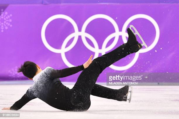Canada's Patrick Chan falls as he competes in the men's single skating short program of the figure skating event during the Pyeongchang 2018 Winter...