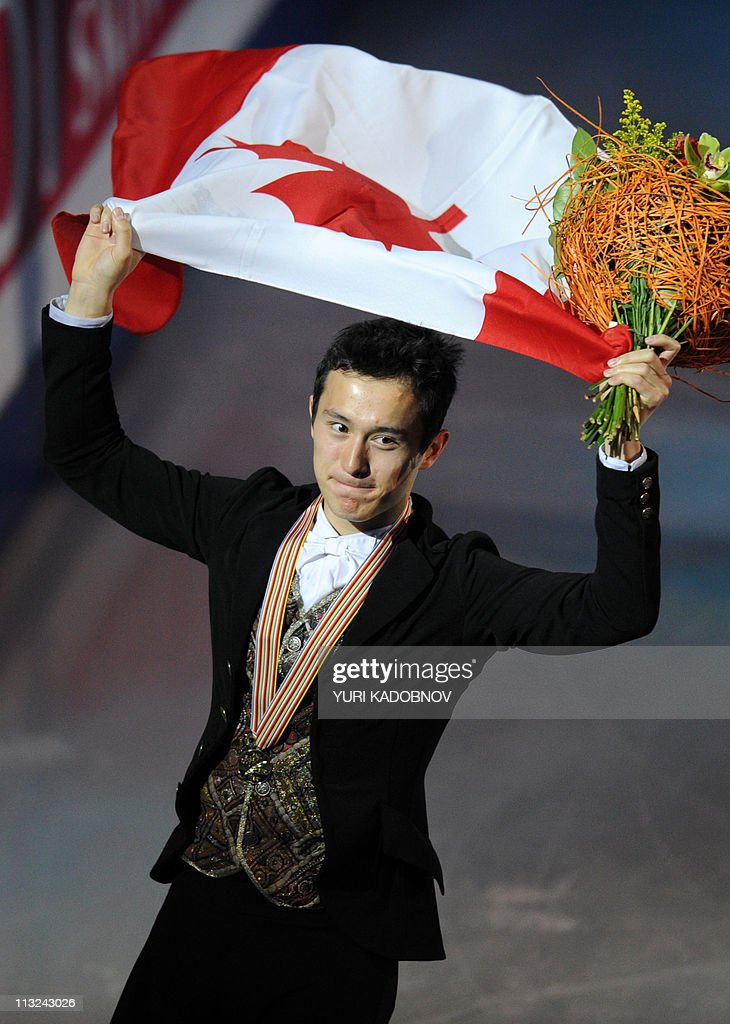Canada's Patrick Chan holds flowers and the Canadian flag after winning the men's free skating event of the ISU World Figure Skating Championships on April 28, 2011 in Moscow. Chan arrived ahead of Kozuka and Gachinski.