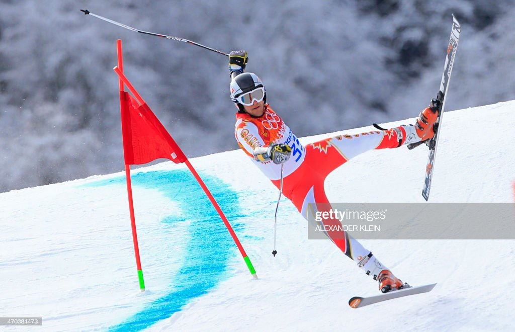 Canada's Philip Brown falls during the Men's Alpine Skiing Giant Slalom Run 1 at the Rosa Khutor Alpine Center during the Sochi Winter Olympics on February 19, 2014.