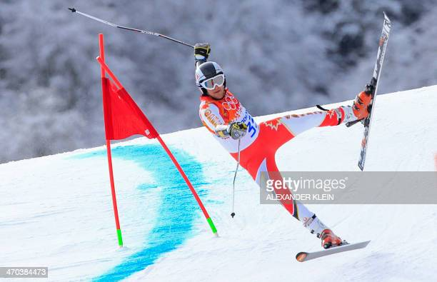 Canada's Philip Brown falls during the Men's Alpine Skiing Giant Slalom Run 1 at the Rosa Khutor Alpine Center during the Sochi Winter Olympics on...