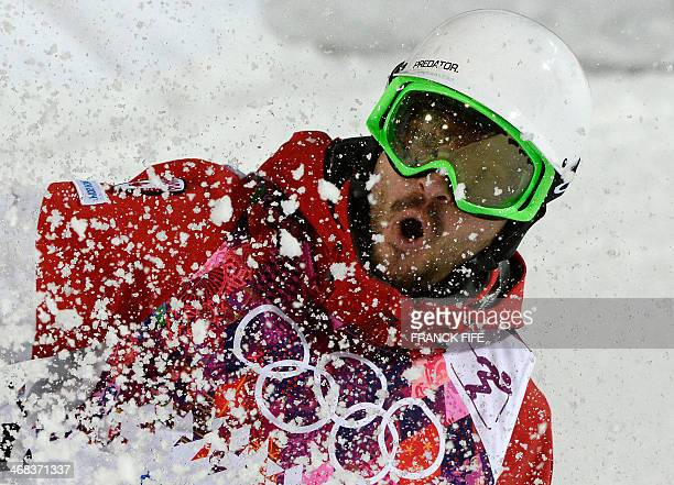 Canada's Philippe Marquis competes in the Men's Freestyle Skiing Moguls finals at the Rosa Khutor Extreme Park during the Sochi Winter Olympics on...