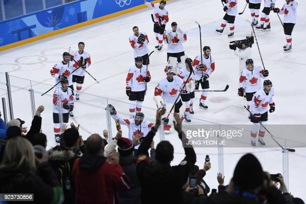 Canada's players acknowledge their fans after winning the men's bronze medal ice hockey match between the Czech Republic and Canada during the...