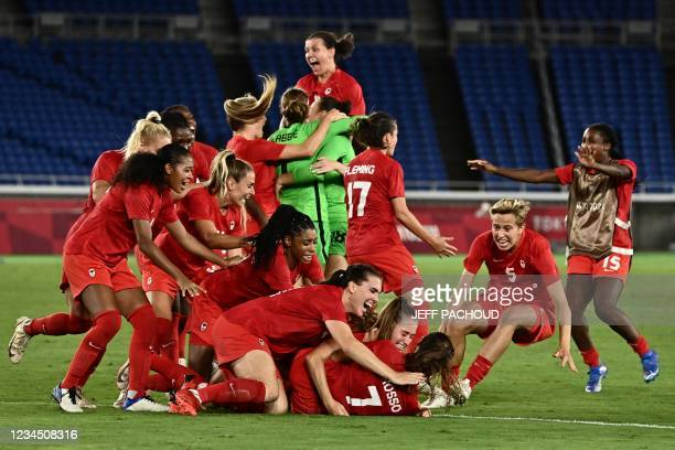 Canada's players celebrate after midfielder Julia Grosso scored the winning penalty during the penalty shoot-out of the Tokyo 2020 Olympic Games...