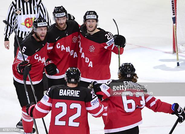 Canada's players celebrate after scoring a goal during the gold medal match Canada vs Russia at the 2015 IIHF Ice Hockey World Championships on May...