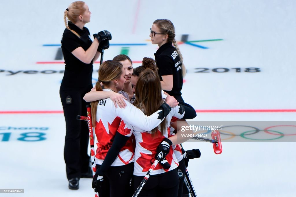 Canada's players celebrate after winning the curling women's round robin session between the Olympic Athletes from Russia and Canada during the Pyeongchang 2018 Winter Olympic Games at the Gangneung Curling Centre in Gangneung on February 21, 2018. / AFP PHOTO / WANG Zhao