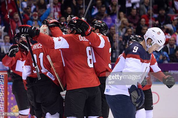 Canada's players celebrate after winning the Men's Ice Hockey Semifinal match between the USA and Canada as US Zach Parise at the Bolshoy Ice Dome...