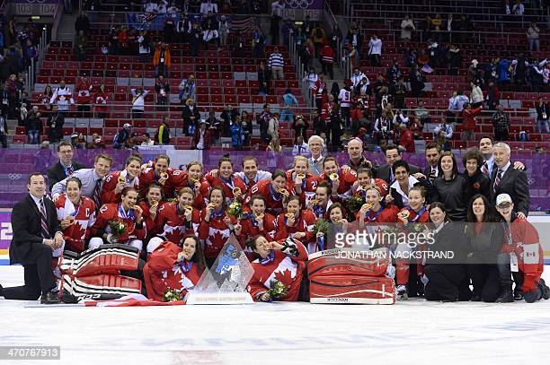 Canada's players celebrate during the Women's Ice Hockey Medal Ceremony after the final game Canada vs USA at the Bolshoy Ice Dome plaza during the...