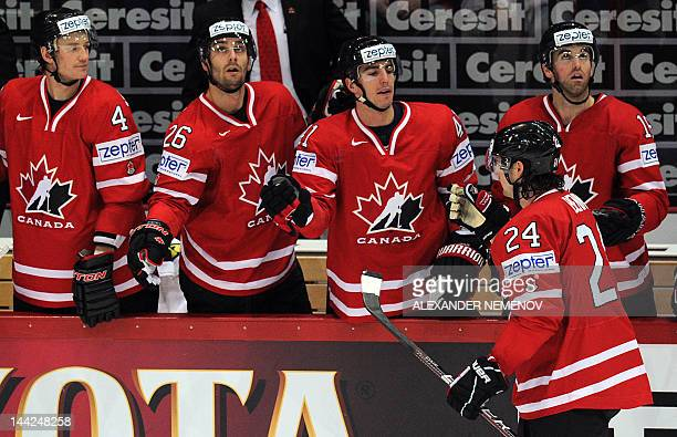 Canada's players celebrate scoring against Kazakhstan during a preliminary round match of the IIHF International Ice Hockey World Championship in...