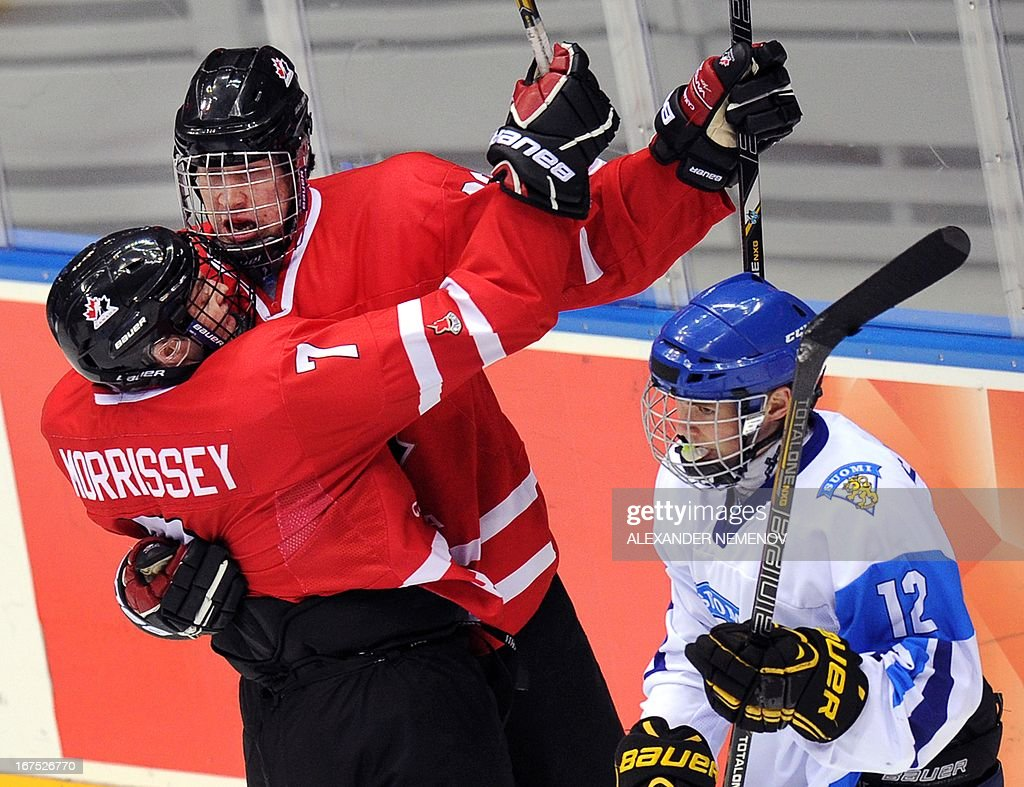 Canada's players celebrate scoring against team Finland during a semi-final game of the IIHF U18 International Ice Hockey World Championship in Sochi on April 26, 2013.