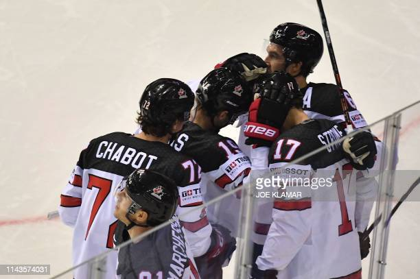Canada's players celebrate scoring during the IIHF Men's Ice Hockey World Championships Group A match between Slovakia and Canada on May 13, 2019 in...