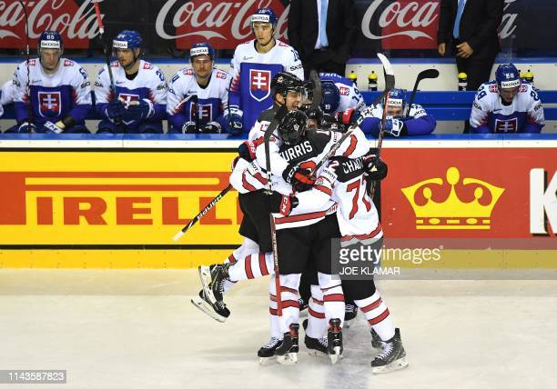 Canada's players celebrate the winning goal during the IIHF Men's Ice Hockey World Championships Group A match between Slovakia and Canada on May 13,...