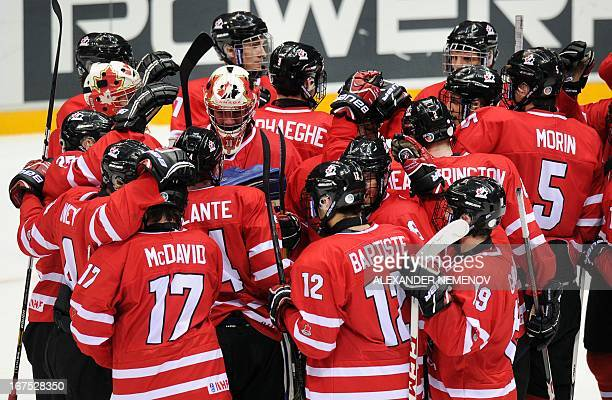 Canada's players celebrate their 31 victory over team Finland during a semifinal game of the IIHF U18 International Ice Hockey World Championship in...