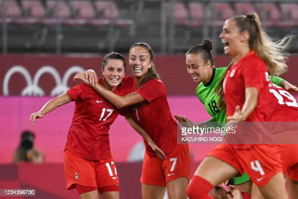 Canada's players celebrate their win in the Tokyo 2020 Olympic Games women's semi-final football match between the United States and Canada at...