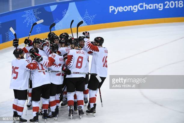 Canada's players celebrate winning the men's bronze medal ice hockey match between the Czech Republic and Canada during the Pyeongchang 2018 Winter...