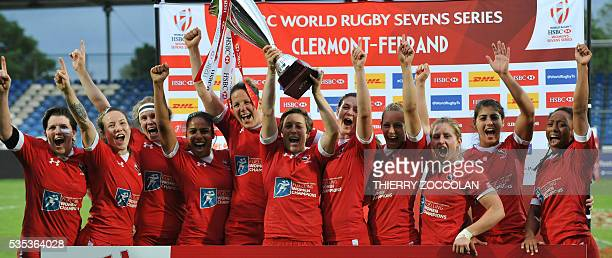 Canada's players celebrate winning the tournament at the end of the World Rugby Women's Sevens Series on May 29 2016 at the Gabriel Montpied stadium...