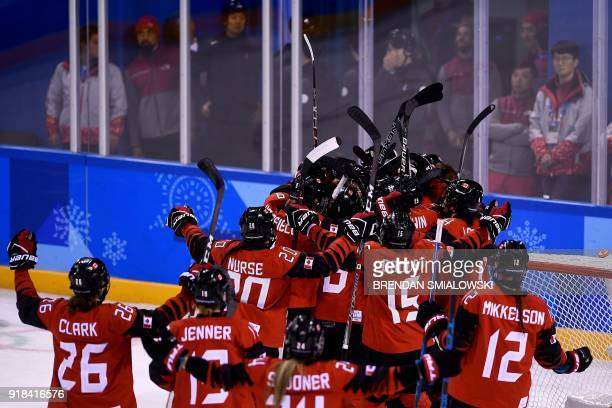 TOPSHOT Canada's players celebrate winning the women's preliminary round ice hockey match between the US and Canada during the Pyeongchang 2018...