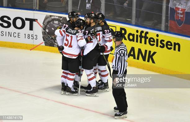 Canada's players celebrates the 4-4 during the IIHF Men's Ice Hockey World Championships Group A match between Slovakia and Canada on May 13, 2019 in...